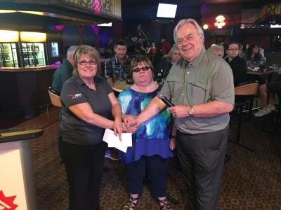 Photo of Doris, Christine and Winnipeg East Rotary member on right presenting a cheque to VIRN.