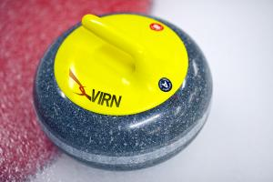 Photo of yellow curling rock with VIRN logo on it.