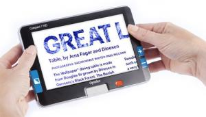 Graphic of high definition handheld video magnifier with a large 7-inch widescreen.