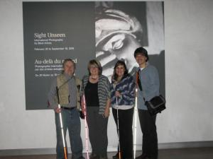 Photo of four VIRN members at the Human Rights Museum showing their mobility canes.